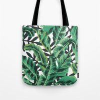 tropical Tote Bags featuring Tropical Glam Banana Leaf Print by Nikki