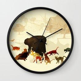 Woman feeding cats Wall Clock