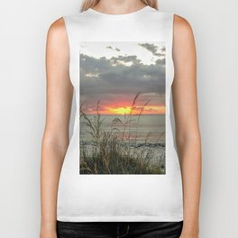 colorful sunset in new zealand on black sand and grass Biker Tank