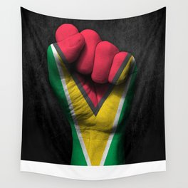 Guyanese Flag on a Raised Clenched Fist Wall Tapestry
