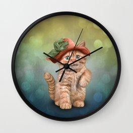 Little funny striped kitten in a big hat Wall Clock