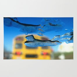 yellow bus and ice photography Rug