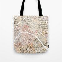 paris map Tote Bags featuring Paris map by Mapsland