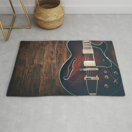 Guitar on Wood Rug