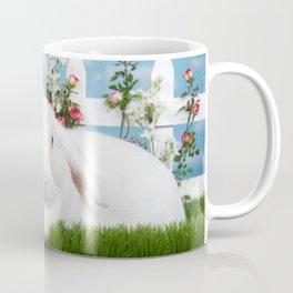 White lop eared bunny in a flower garden Coffee Mug