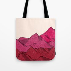 The falling snow and the mountains Tote Bag