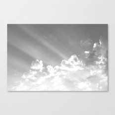 Cotton clouds and sunrays Canvas Print