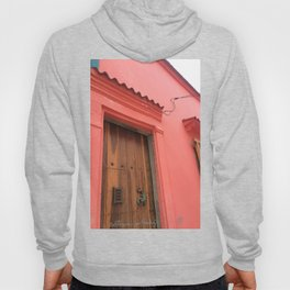 Cartagena is Peachy, Colombia, South America. Coral Pink Building with Ornate Lizard design Hoody