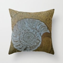 Ammonite in fossilized river bed Throw Pillow
