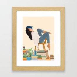 Lost in my books Framed Art Print