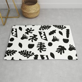 Black and white tropical house plant leaves minimal linocut pattern graphic scandi design Rug
