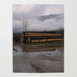 Timber Logs With A Foggy Mountain View Poster