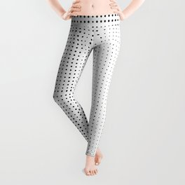 Rhythm of black dots on white background Leggings