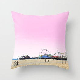 Santa Monica Pier with Ferries Wheel and Roller Coaster Against a Pink Sky Throw Pillow
