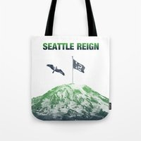 seahawks Tote Bags featuring SEATTLE REIGN by Brandon sawyer