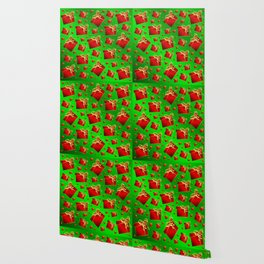 many little red gifts with golden bow on green Wallpaper