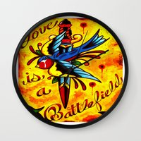 battlefield Wall Clocks featuring Love Is A Battlefield by ARMADA Industries