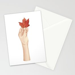 Holding the autumn Stationery Cards
