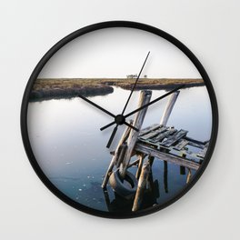 Weathered and rickety wooden dock almost collapsing in the Aveiro lagoon. Wall Clock