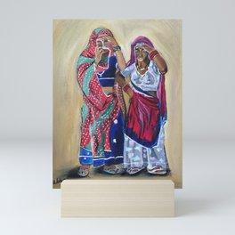 Oil painting of two Indian women peeping through their sari. Mini Art Print