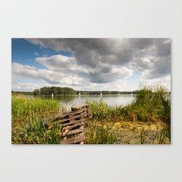 Old bridge and boats at the lake Canvas Print