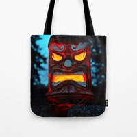 returns Tote Bags featuring Tiki returns by Vorona Photography