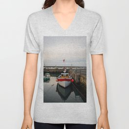 A quaint fishing boat rests in Amble harbour at dusk, Northumberland, England Unisex V-Neck