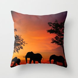 Elephants in the African sunset Throw Pillow