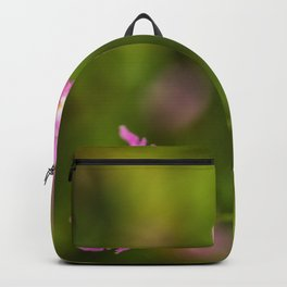 purple flowers on green background Backpack