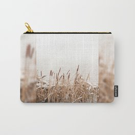 Snow on Typha reeds and frozen water Carry-All Pouch