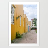 Yellow houses, pink flowers - Curacao Art Print