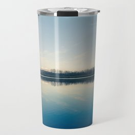 A blue  winter lake Travel Mug