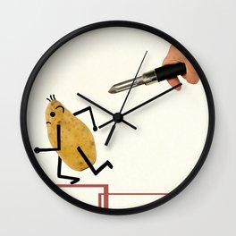 Potatoes fleeing the vegetable peeler. Wall Clock