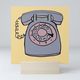 Rotary phone in yellow Mini Art Print