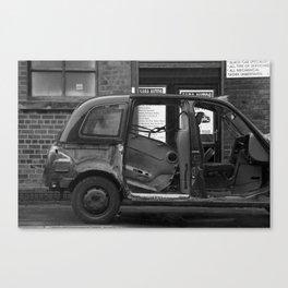 A broken black cab Canvas Print