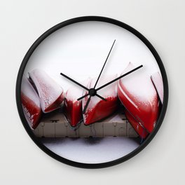 Snowfall on Red Canoes in Jasper National Park Wall Clock