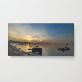 Sun with faint halo over the calm sea and reef rocks Metal Print