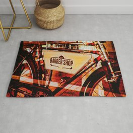 Barber shop vintage photograph of an antique bicycle Rug