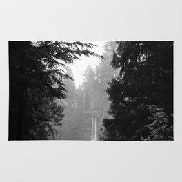 misty capilano suspension bridge Rug