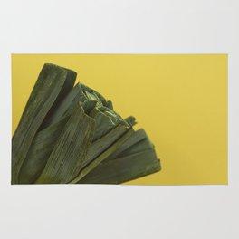Leeks on yellow Rug