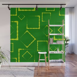 Yellow rhombuses and squares on a green background. Wall Mural
