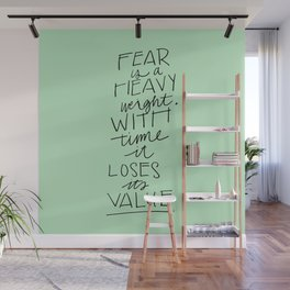 Fear is a heavyweight, with time it loses its value Quote Wall Mural
