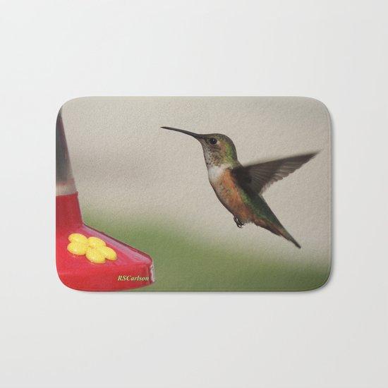 Ms. Hummingbird Checks the Feeder Bath Mat