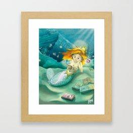 How mermaids get new books Framed Art Print