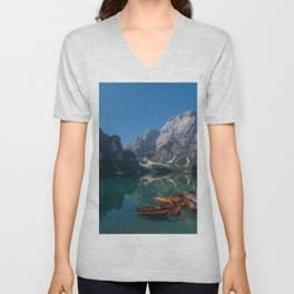 The Seekofel mountains and wooden boats reflected in the waters of Lake Braies Unisex V-Neck