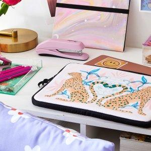 desk with pastel colored decor