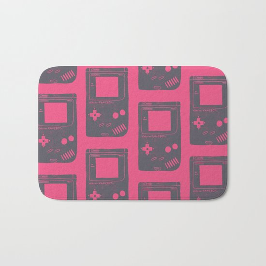 Game Boy on pink Bath Mat