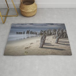 Footprints and Pilings on the Beach at Kirk Park by Grand Haven Michigan Rug
