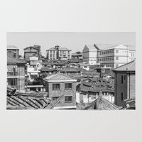 seoul Area & Throw Rugs featuring Seoul Rooftops by Jennifer Stinson
