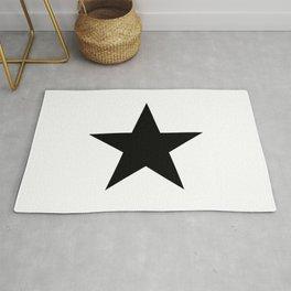 Single black star on white Rug